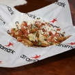 Minute Maid Park World Series food Green Chili Chicken Stak – fresh cut fries topped with green Chili chicken, pico de gallo and cotija cheese