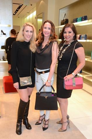 Christie Sullivan, from left, Liz Glanville and Debbie Festari at the Una Notte in Italia lunch at Valentino September 2014