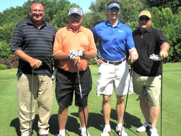 Jeff Leggett, Dennis Leach (Ecolab), Justin Merritt and Shaun Young , promise house golf tournament