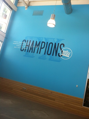 Whole Foods Market Champions sign