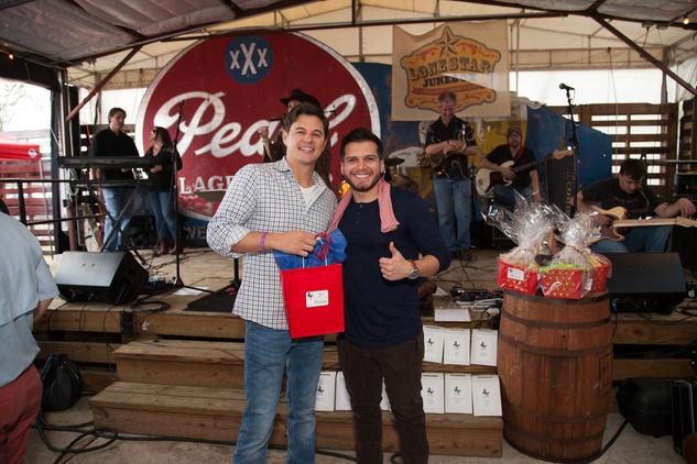 Joe Huber, left, and Andres Jaramillo at the Casa de Esperanza's Young Professionals 5th Annual Chili Cook Off February 2015