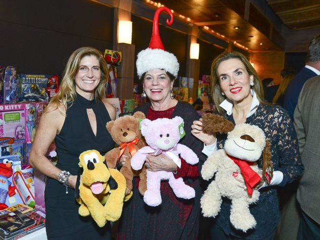 4 Edie Saville, from left, Andy Delery and Celina Hellmund at Joyful Toyful December 2013