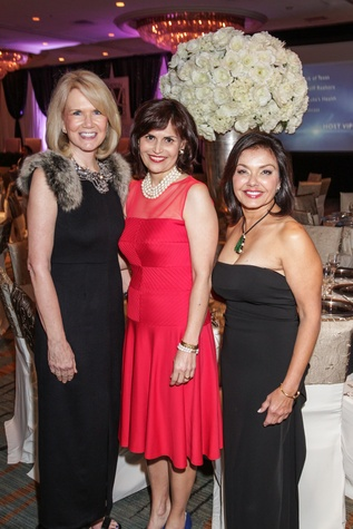 Suzan Deison, from left, Denise Castillo-Rhodes and Samina Farid at the Women's Chamber of Commerce Hall of Fame Gala December 2014