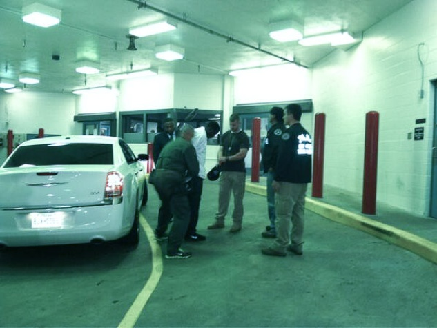 Quanell X and La-Melvin D. Johnson turn in after declaring self-defense in car wash shootings October 2013