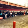 A line of people wait at the Crawfish Shack in Crosby