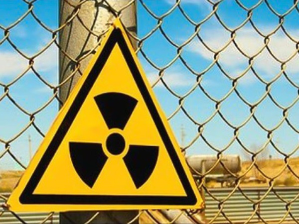 radioactive sign, chain-link fence