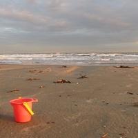 Jamaica Beach on Galveston Island play dump truck and sand bucket