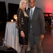 Theresa Roemer and Christopher Mitchell at fashion preview party in The Woodlands