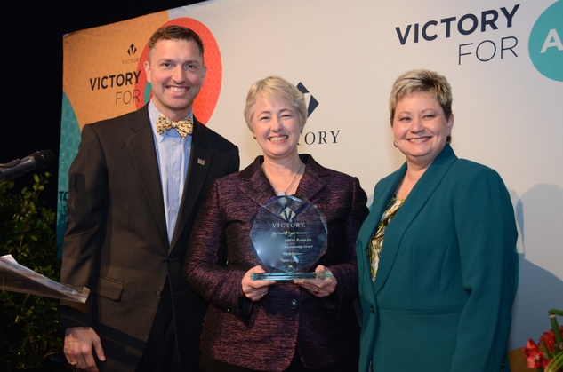 221 Ryan Lindsay, from left, Mayor Annise Parker and Tammi Wallace at the Victory Brunch March 2015