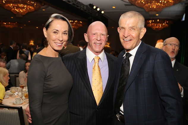 15 Sue and Lester Smith, from left, with Jim McIngvale at the Guardian of the Human Spirit luncheon November 2014