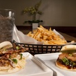 Fat Bao Crab Daddy Bao, pork belly bao and french fries fried potatoes topped with parmesan and rosemary