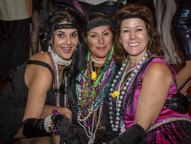 9913 Cindy Burkett, from left, Darcie Schlegel and Valerie Nabizadch at the Tremont Ball March 2014