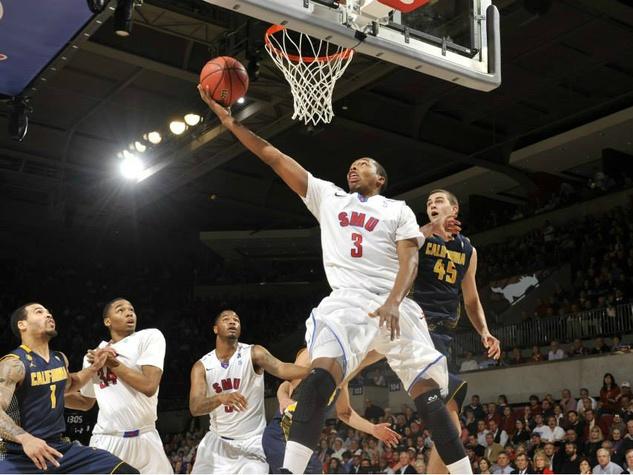 SMU basketball player dunks