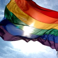 News_Rainbow flag_gay pride_sky_clouds