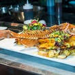 Whole red snapper with Lyonnaise potatoes and beurre blanc at Madrina restaurant in Dallas