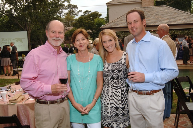 Brad and Stephanie Tucker, from left, with Allison Darden and Samuel Tucker at the Katy Prairie Conservancy fundraiser May 2014