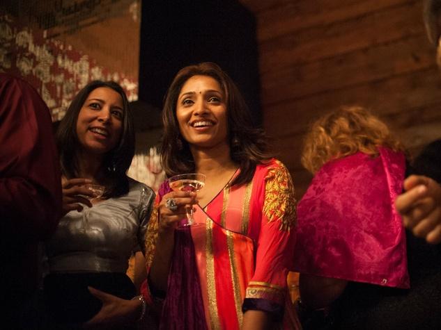 Taruna Jain and Hyma Chilakapati watch the fashion show at Bollywood Ball