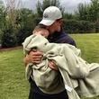 Johnny Manziel holds a sick child