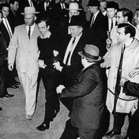 Lee Harvey Oswald being shot by Jack Ruby