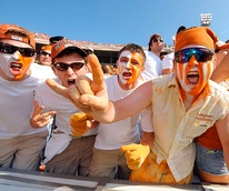 University of Texas at Austin hellraisers guys with painted faces at football game partying