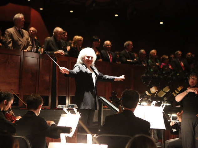 Donna Bruni conducts the National Anthem at the Houston Grand Opera Opening Night celebration October 2013