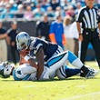 Dallas Cowboy Josh Brent sacks Carolina Panther Cam Newton