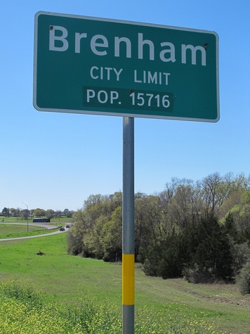 News_Ruthie_Brenham and Bluebonnets_Brenham_Sign_city limits