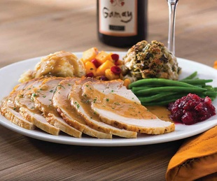 Seasons 52 turkey with dressing cranberry sauce green beans and dressing
