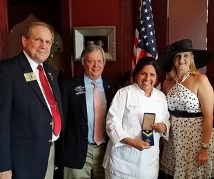 Rotary District governor Bob Gebhard, from left, Rotary International treasurer and director Andy Smallwood, chef Kiran Verma and Rhonda Walker Kirby at Rotary tea June 2014