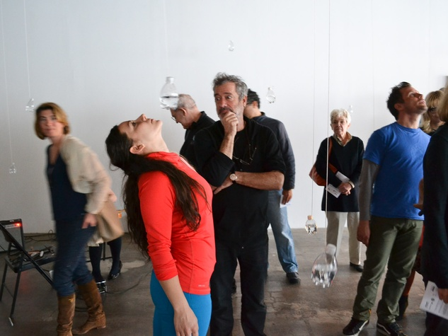 Nancy, the performance experience, Tony Feher looks on as Kristen Frankiewicz interacts with his DiverseWorks installation Free Fall