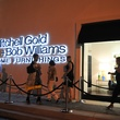 store exterior at night with people at the Mitchell Gold + Bob Williams Houston grand opening celebration