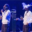 Cropped photo of Snoop Dog partaking at Club Nomadic