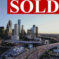 Houston downtown skyline with big sold sign on top