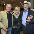9 David Baird, from left, Bonnie Laughlin and Tom Davis at the RodeoHouston Wine Auction Dinner March 2014