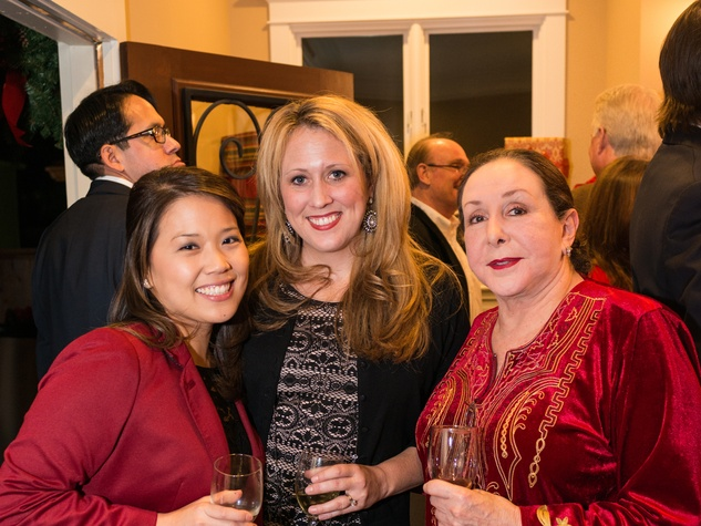 2089 31 Vicky Wu, from left, Ginny Ledwell and Najla Tanas at the Joiner holiday party December 2013