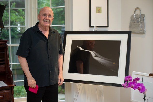 Joe Aker in front of his artwork at Planned Parenthood Fine Art Auction