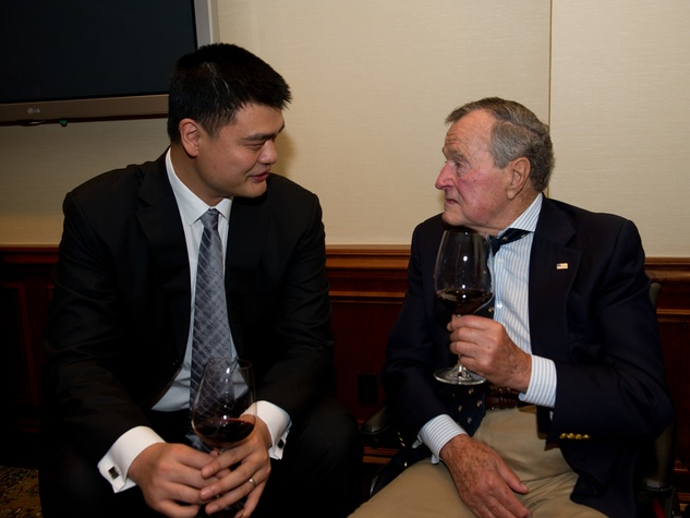 Yao Ming, left, and President George H.W. Bush at the George Bush Presidential Library Foundation dinner December 2013