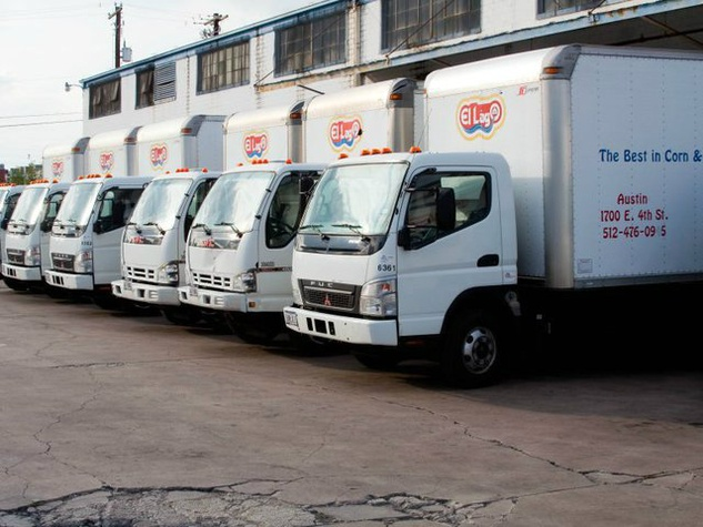 line of delivery trucks for El Lago Mexican Foods