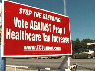 Austin Photo: News_roger falk_healthcare_Oct 2012_sign