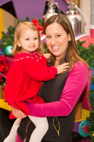 Laurie Lister and child at Childen's Museum Grinch party