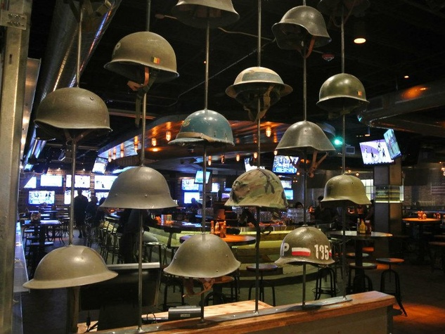 Bombshells Restaurant & Bar Dallas interior with military helmuts