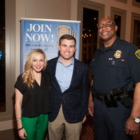 Stacy and Jason Johnson, from left, with Charles McClelland at the Houston Police Department benefit April 2015
