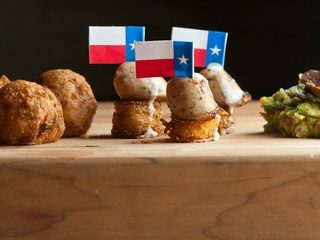 Lonesome Dove Austin restaurant first course rattlesnake sausage Texas flag