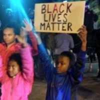 18 Houston Ferguson protest November 2014 The babies out here protesting with us. #Houston #Ferguson