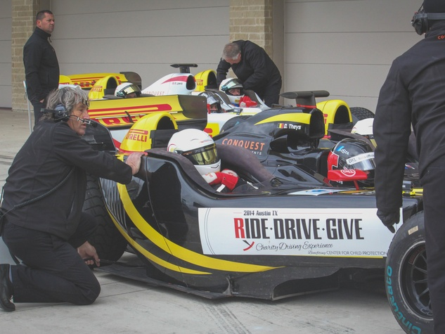 pit crew for Formula 1 ride along in pit lane for Ride Drive Give benefit