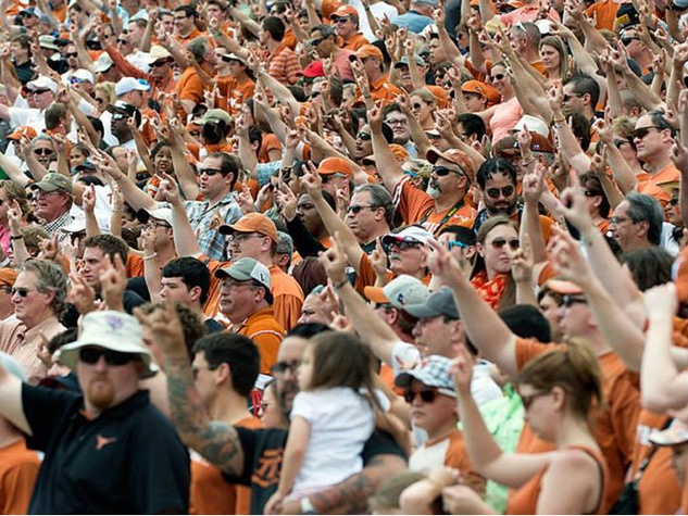 Texas Longhorn fans at DKR giving hook em for spring game