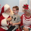 167 A patient talks with Santa and Mrs. Claus at Santa visits Texas Children's Cancer Center December 2014