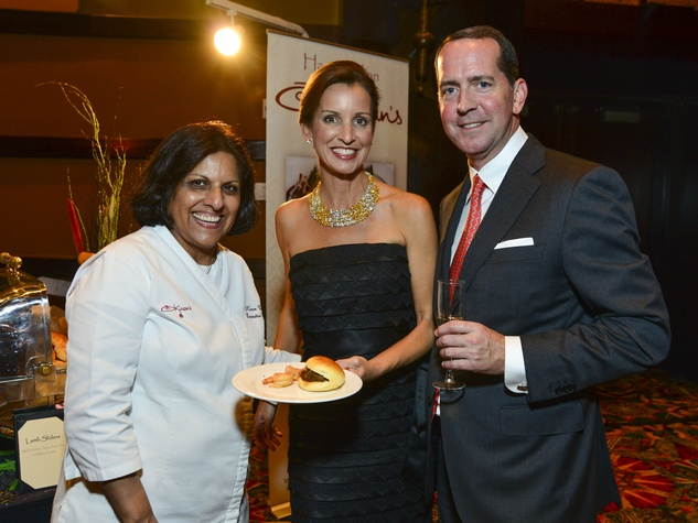12 Chef Kiran Verma of Kiran's, from left, Julie Oliver and Steven Cowan at the March of Dimes Signature Chefs event October 2013