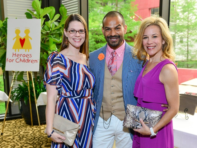 32 Jenny Dowen, from left, Todd Ramos and Larissa Lenton at Heroes and Handbags May 2014