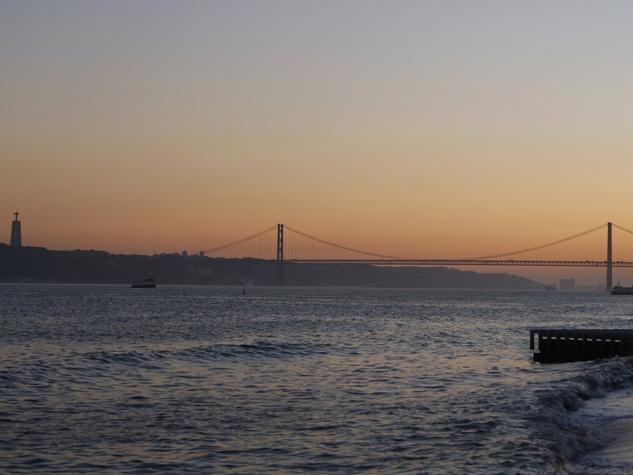Bill Van Rysdam  Lisbon March 2105 The 25 de Abril Bridge with the Christo Reo statue at sunset